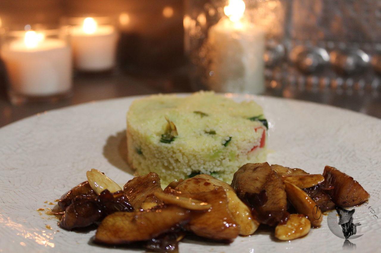 Pollo en almendra, soja y miel con  cous cous.